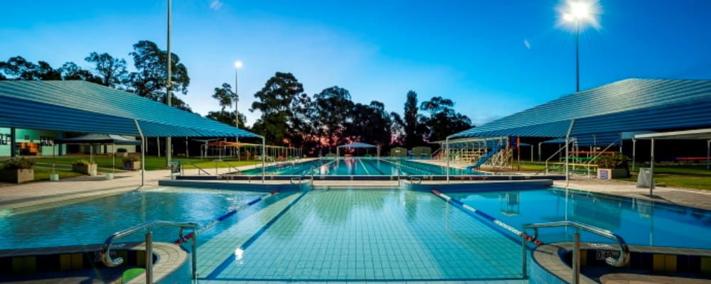 image of a public swimming pool at twilight