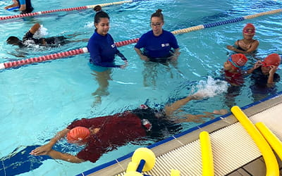 Aboriginal children in the pool with two swim instructors
