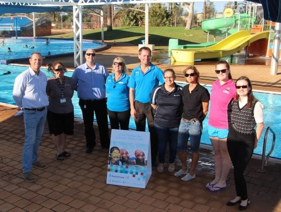 Royal Life Saving Society WA CEO Peter Leaversuch with key stakeholders from across the Pilbara, gathered by the pool at South Hedland Aquatic Centre