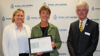 Nicole Durrant receiving her award from Beyond Bank's Georgie Nicholas and RLSSWA President Colin Hassell