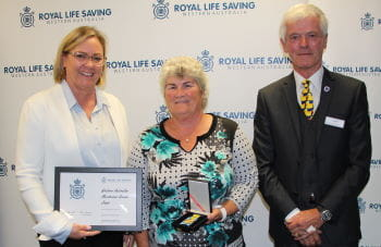 Sandra Rawlings receiving her award from Beyond Bank's Georgie Nicholas and RLSSWA President Colin Hassell