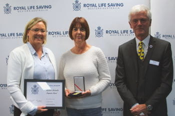 Lesley Ayers receiving her award from Beyond Bank's Georgie Nicholas and RLSSWA President Colin Hassell