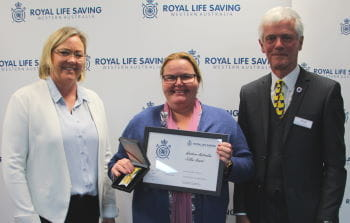 Catherine Cruttenden receiving her award from Beyond Bank's Georgie Nicholas and RLSSWA President Colin Hassell