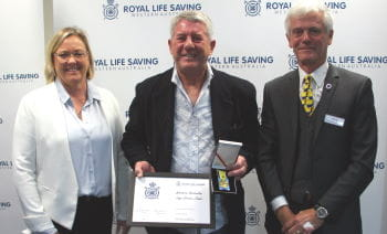 Jamie Back receiving his award from Beyond Bank's Georgie Nicholas and RLSSWA President Colin Hassell