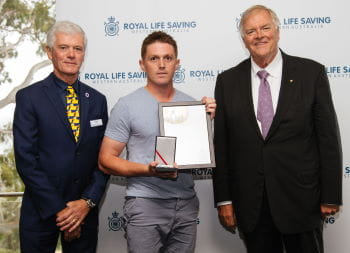 Daniel Crook receiving his Bravery Award from RLSSWA President Colin Hassell and WA Governor Kim Beazley