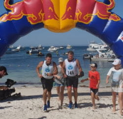 Terry and Ross at the finish line of the Rotto Swim Run