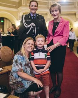Finnley with his mum Angela, Governor Kerry Sanderson AO and her guard