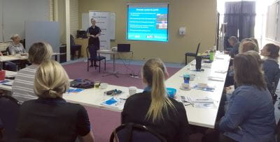 Trainers watching a presentation during their PD session in Bunbury