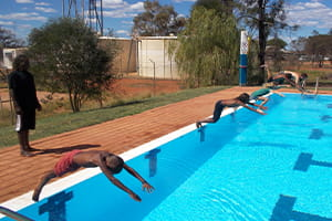 Aboriginal kids diving into the Burringurrah swimming pool