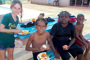 Happy children at Burringurrah eating fruit at the local pool