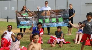 Federal Member for Burt Matt Keogh with program coordinators Sam Bell and Emily Balcombe and children from the Champion Lakes Swim and Survive program