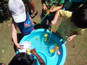 Children enjoying the water play table at our Children's Week stall