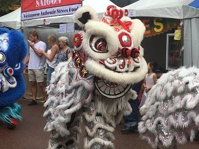 A white Chinese dragon walking through the Chinese New Year Fair