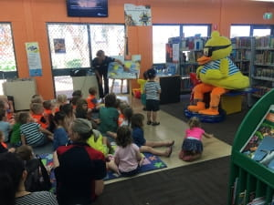 Dippy duck read a story to a large group of kids
