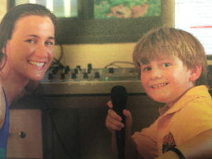 A young Dylan interviewing swimmer Sophie Edington