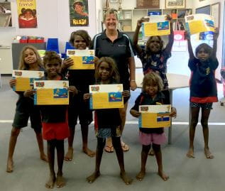 Children from the Fitzroy Valley with Pool Manager Adele Caporn, holding their Swim and Survive certificates