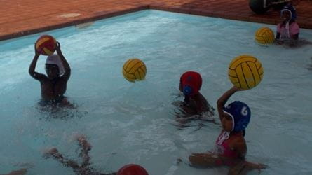 Children learning Flippa Ball at Yandeyarra pool