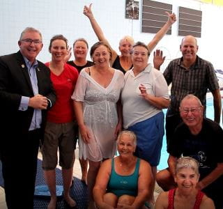 Local MLA Mark Folkard with Grey Medallion participants by the pool at Arena Joondalup
