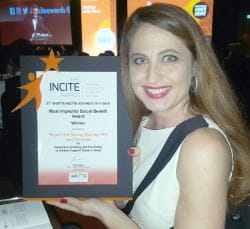 Royal Life Saving's Laura Kazmirowicz holding up our Incite Award certificate