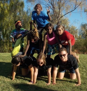 aboriginal children with Fairgame leaders building a human pyramid