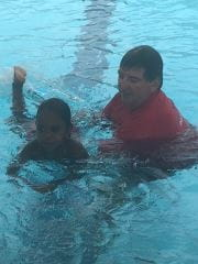 David with a child in the pool