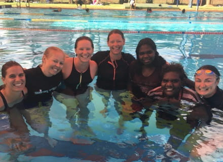 a group of seven women in the water completing swim instructor training in Newman