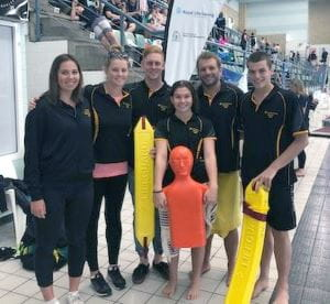 Members of the WA pool lifesaving team by the pool at the JLC State Titles
