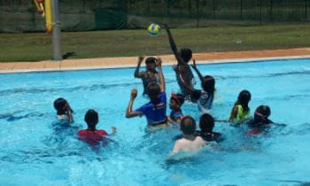 Aboriginal children from Warmun enjoying pool games in the community's swimming pool
