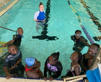 Kenyan children in the pool with their swim instructor