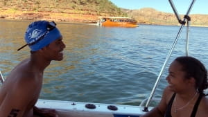 Two RLSSWA competitors in the boat during the Lake Argyle Swim