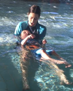 Levi with his swim instructor in the water at Terry Tyzack