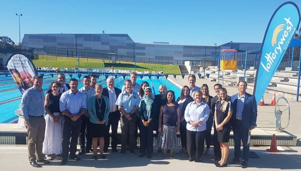Royal Life Saving staff and stakeholders with Sport and Recreation Minister Mick Murray and representatives from Lotterywest and the Department of Local Government, Sport and Cultural industries by the pool at HBF Stadium