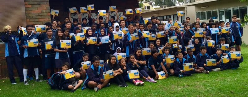 Multicultural children at Lynwood Senior High School showing off their Swim and Survive certificates