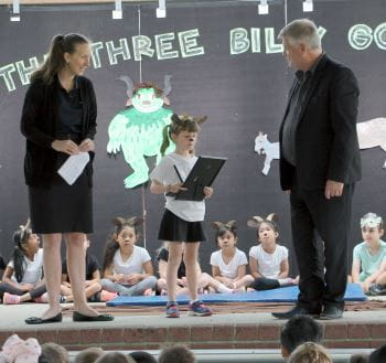 Keep Watch Coordinator Rachel Murray and Bateman Primary Principal Marc Lockett on stage with Mill receiving her award at the school assembley