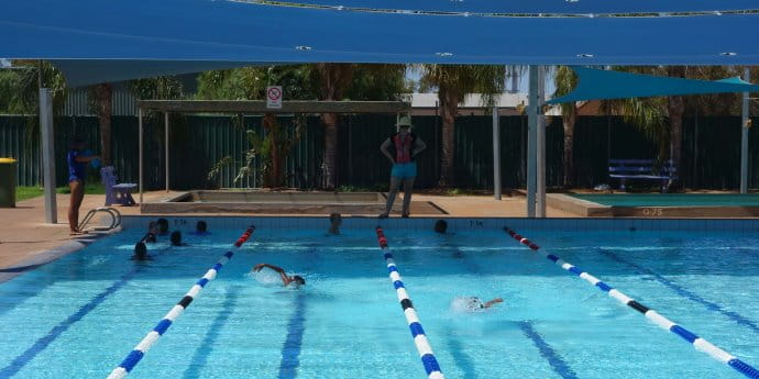 kids swimming in the Mount Magnet pool with instructor looking on