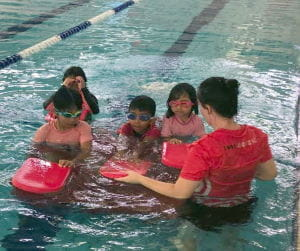 Multicultural children with their swim instructor in the pool at Swan Active Ballajura