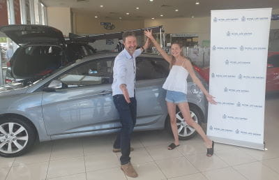 Raffle winner Dean English and daughter Carrie English with their brand new Hyundai