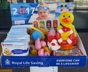 A Royal Life Saving Day merchandise box