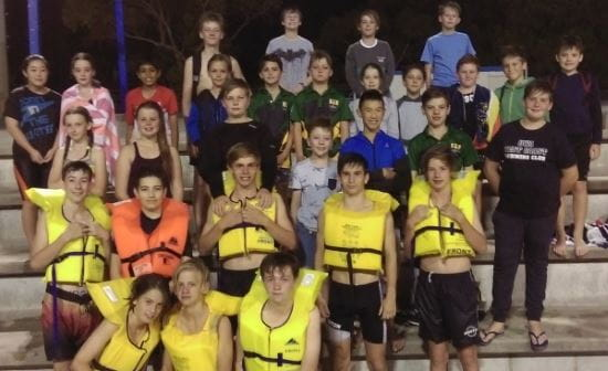 Scouts members gathered on the steps at HBF Stadium wearing lifejackets