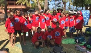 Aboriginal children in red Spirit Carnival t shirts on the grass at the Gratwick Aquatic Centre