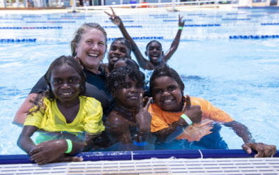 Aboriginal children with a swim instructor in the pool