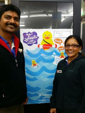 image of IGA Morley staff with Stick-a-duck pond poster