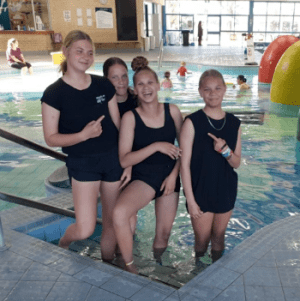 Four Aboriginal girls standing on the steps of the pool at Swan Active Midland