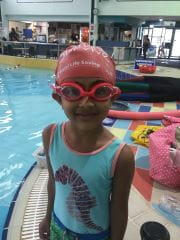 Little girl in swimming cap and goggles