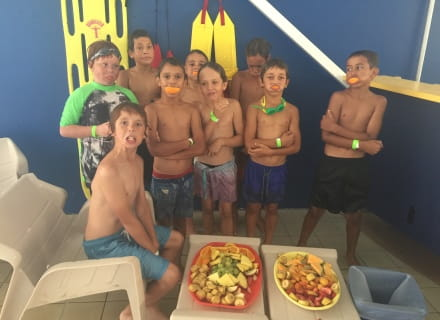 Nine boys eating from a platter of fruit after enjoying swimming lessons as part of the Go for 2 and 5 Swim for Fruit initiative at Geraldton Aquarena