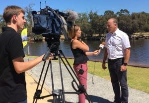 Federal MP Steve Irons being interviewed by a GWN reporter with a cameraman
