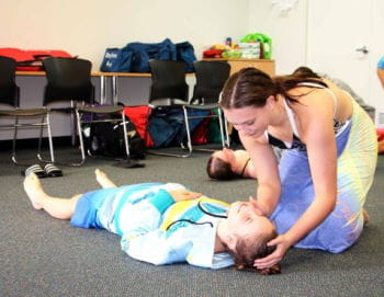 Two girls practising first aid skills