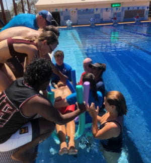 Talent Pool participants practising spinal management skills in the pool at Broome