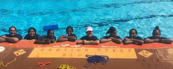 Talent Pool participants with their trainer in the water at Roebourne