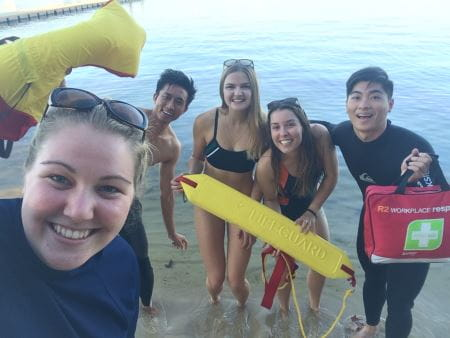 A trainer and four students with lifesaving gear having fun by the Swan River